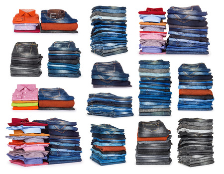 pile of clothes: collection stacks of jeans on a white background