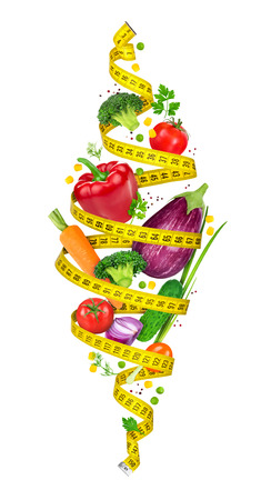 Concept of diet. Measuring tape spiral twists vegetables in the air on a white background