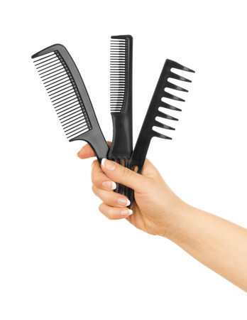 combs in her hand isolated on a white Stok Fotoğraf