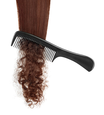 hairbrush: hairbrush and lock of hair on a white