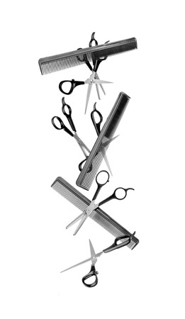 collection of hairdressing equipment isolated on white photo