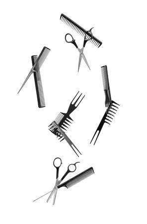 falling hairdressing tools on white background photo