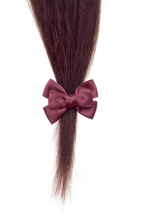 strand of hair: strand of hair on a white background