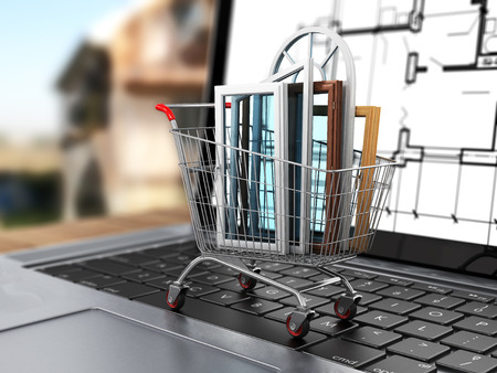 warm house: The windows in the shopping cart on notebook keyboard. E-commerce. Concept of warm house.