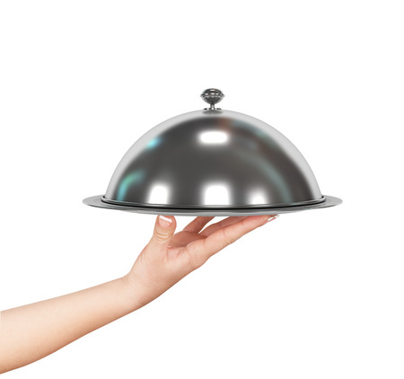 food stuff: Close up hand of waiter with metal cloche lid cover and tray Stock Photo