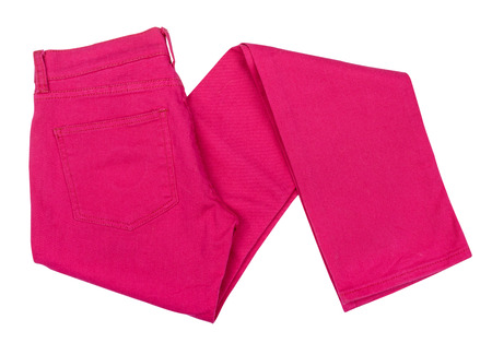 clothes interesting: bright pink jeans folded on isolated white background Stock Photo