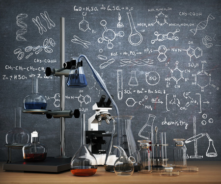Chemistry laboratory concept. Laboratory chemical test tubes and objects on the table with chemistry draw on whiteboard.