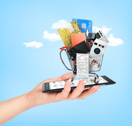 Online winkel concept. Vrouwelijke greep hand telefoon met grote huishoudelijke apparaten en check-in boodschappenwagentje op hemel achtergrond. E-commerce.