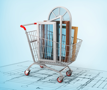 warm house: The windows in the shopping cart on the blueprint. Warm house concept. Stock Photo