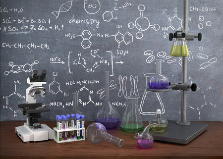 Laboratory chemical test tubes and objects on the table with chemistry draw on whiteboard. Stock Photo