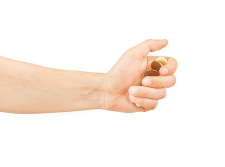 hand with coins isolated on white photo