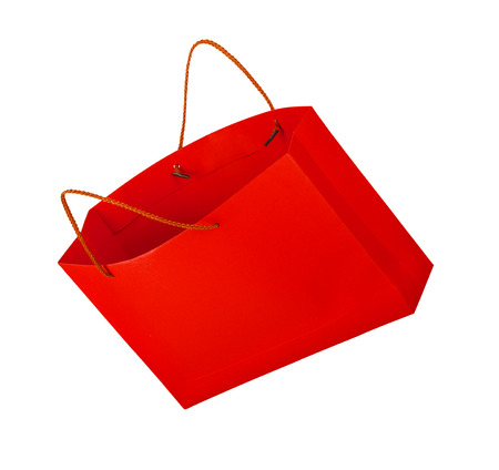 christmas shopping: red shopping bag in the air on an isolated white background Stock Photo