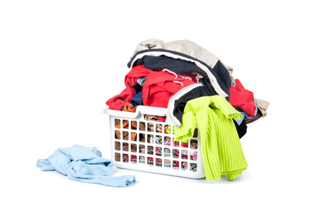 basket: Clothes with basket isolated on white background Stock Photo