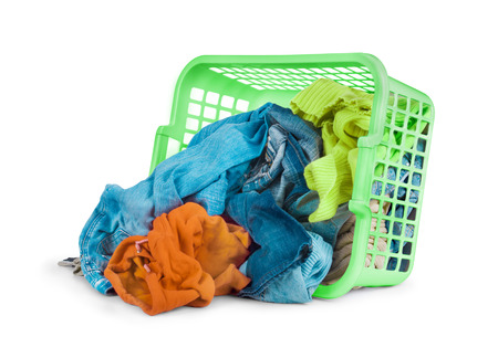 laundry basket: Bright clothes in a laundry basket on white background