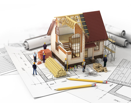 mortgage application: House with open interior on top of blueprints documents and mortgage calculations and builders