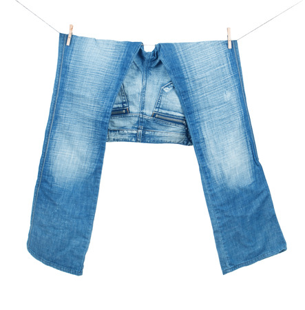 VS Blue jeans on washing line isolated on white photo