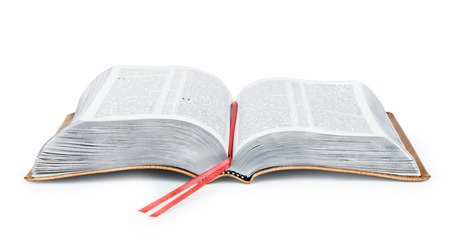A photo of an open Bible isolated on a white background.