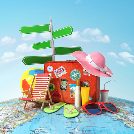 Recreation and travel concept. Road sign old suitcase for travel beach hat beach ball sunglasses sun cream and beach shoes on the world map and blue sky. Direction to recreation.