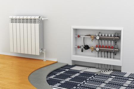 eficiencia energetica: sistema de calefacción por suelo radiante, el colector, la batería Foto de archivo