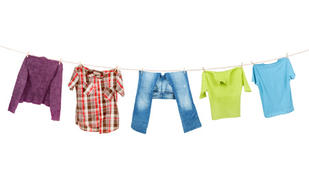 dries: Clothes hanging isolated on white background