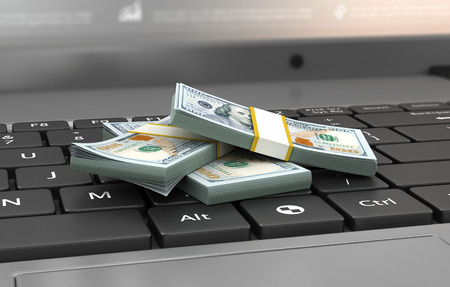 money stack: Finance and earning concept, one hundred dollar banknotes on laptop,