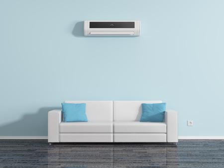 Airconditioning op de muur boven de kussens van de bank.