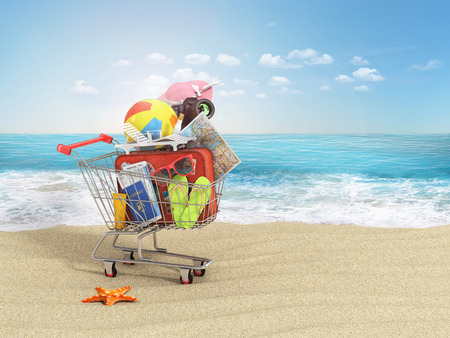 Shopping cart with beach accessories on the beach line. Summer shopping. Sunbed, sunglasses, world map, beach shoes, sunscreen, air tickets, beach ball, camera, hat and old red suitcase for travel in the shopping cart. Summer concept.
