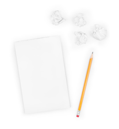 wads: Writing concept - crumpled up paper wads with a sheet of white paper and pencil