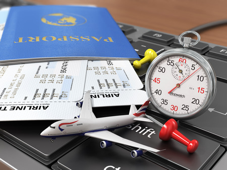 air travel: Travel concept. Passports, airline tickets, stopwatch and airplane on the keyboard. Fast order air tickets.