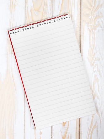 empty pocket: blank realistic spiral Notepad on wooden background Stock Photo