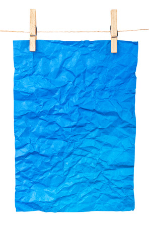 clothespins: blue paper-a poster on clothespins