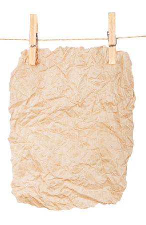 clothespins: paper-a poster on clothespins Stock Photo