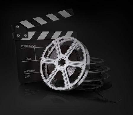film industry: Cinema clap and film reel. Stock Photo