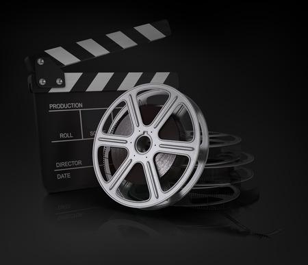 cinema film: Cinema clap and film reel. Stock Photo
