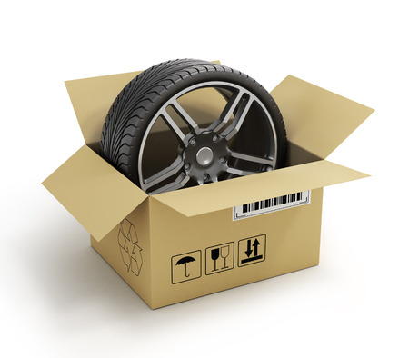 vulcanize: Open Cardboard Box with Tires on white background. Online store of auto parts. Stock Photo