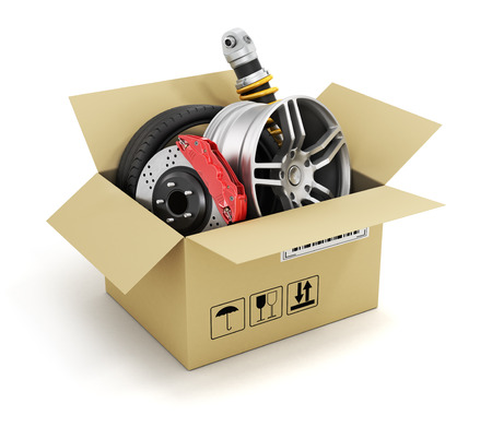 Auto parts in the cardboard box. Automotive basket shop. Auto parts store. 스톡 콘텐츠