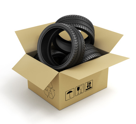 car tire: Open Cardboard Box with Tires on white background. Online store of auto parts. Stock Photo