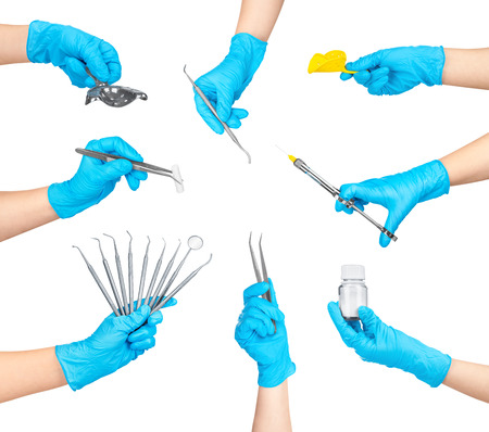linctus: collection of dental instruments in the hands isolated on white background Stock Photo
