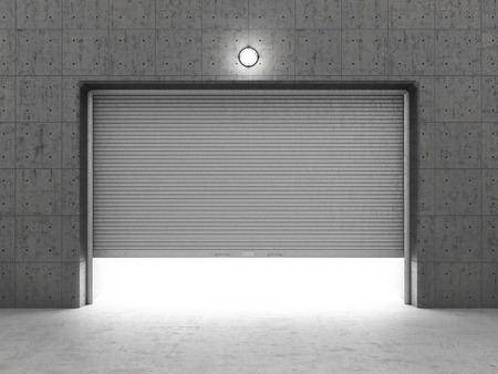 Garage building made of concrete with roller shutter doors. Stockfoto