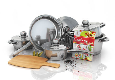 stewing: Set of cooking pots with cookbook and board for rifling. Kitchen set. Stock Photo