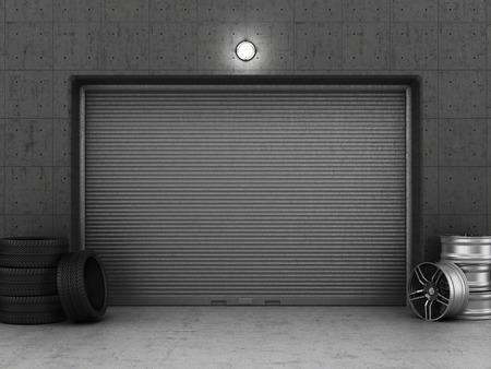 Garage gebouw gemaakt van beton met rolluik deuren, banden en velgen