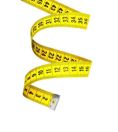 instrument of measurement: spiral measuring tape isolated on white background