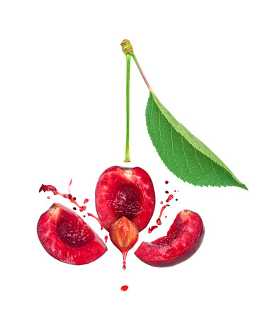 cherry: the explosion of cherries for three slices and a splash of cherry juice isolated on white background