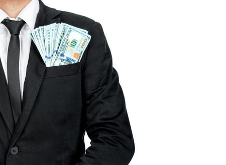 authoritative: Close up of money in male suit pocket.