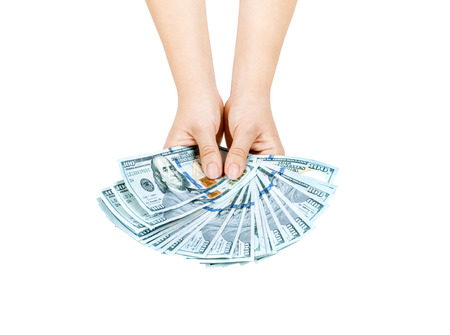 commercial activity: Hand with money isolated on a white background