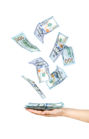 held: Wad of one hundred dollar bills held in hand Stock Photo