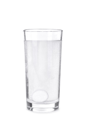 fizzy tablet: Fizzy tablet in glass of water isolated on white Stock Photo