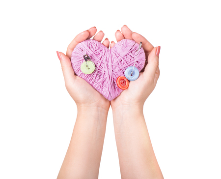 crocheted: Crocheted heart in hand isolated on white