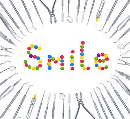 harm: The concept of harm to the teeth. The smile of sweets around dental tools.