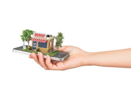 Concetto di e-commerce. Mano azienda di telefonia mobile con negozio nella visualizzazione su uno sfondo bianco. Negozio online. Archivio Fotografico - 45793656